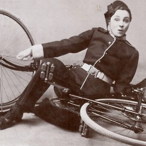 Vesta Tilley falls off a bike.