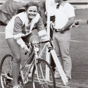 Valerie Perrine rides a bike.