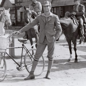 Terence Hill shows off a bike.