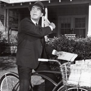 Fred MacMurray rides a bike, delivers the paper.