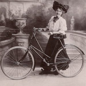 Phyllis Dare with her Raleigh bicycle.