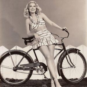 Joan Fulton, aka Joan Shawlee, models a bike.