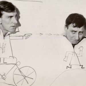 John Wood rides a drawing of a bike, Spike Milligan runs.