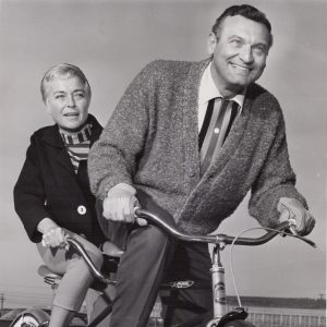 Frankie Laine and Nan Grey ride a bike.