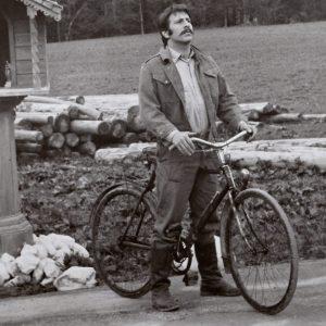 Topol rides a bike.