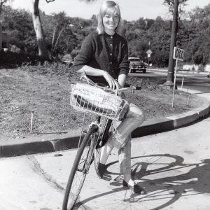 May Britt rides a bike.