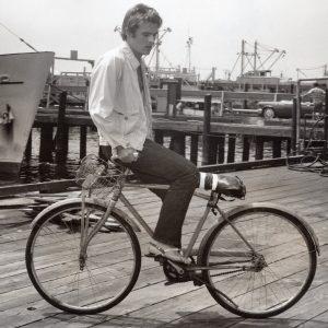 Christopher Jones rides a bike — backwards.