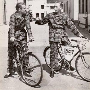Bob Hope and Bing Crosby ride bikes, in matching pajamas.