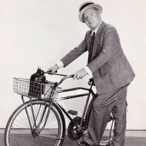 W.C. Fields, bicycle and beverage.