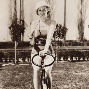 Claire Dodd rides a polo bike.