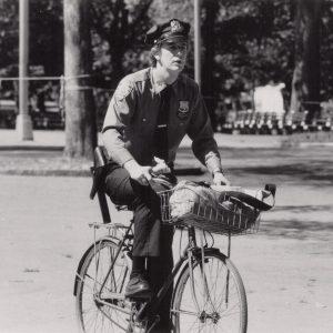 Judge Reinhold rides a bike.