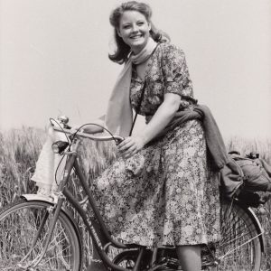 Jodie Foster rides a bike.